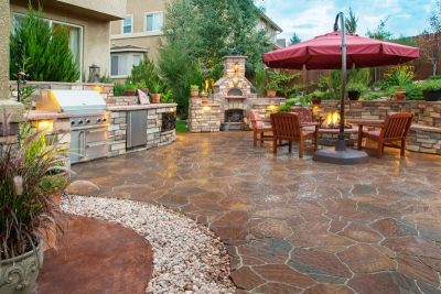 luxury backyard with fire pit and grill