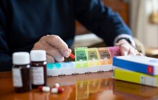 Senior Organizing Man organizing pills