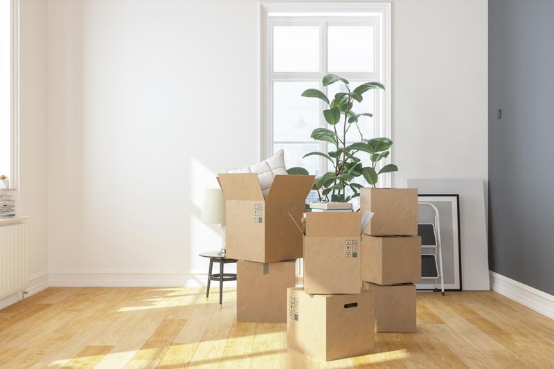 boxes piled in room for downsizing